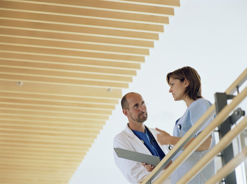 A male and a female healthcare professionals discussing practice management.