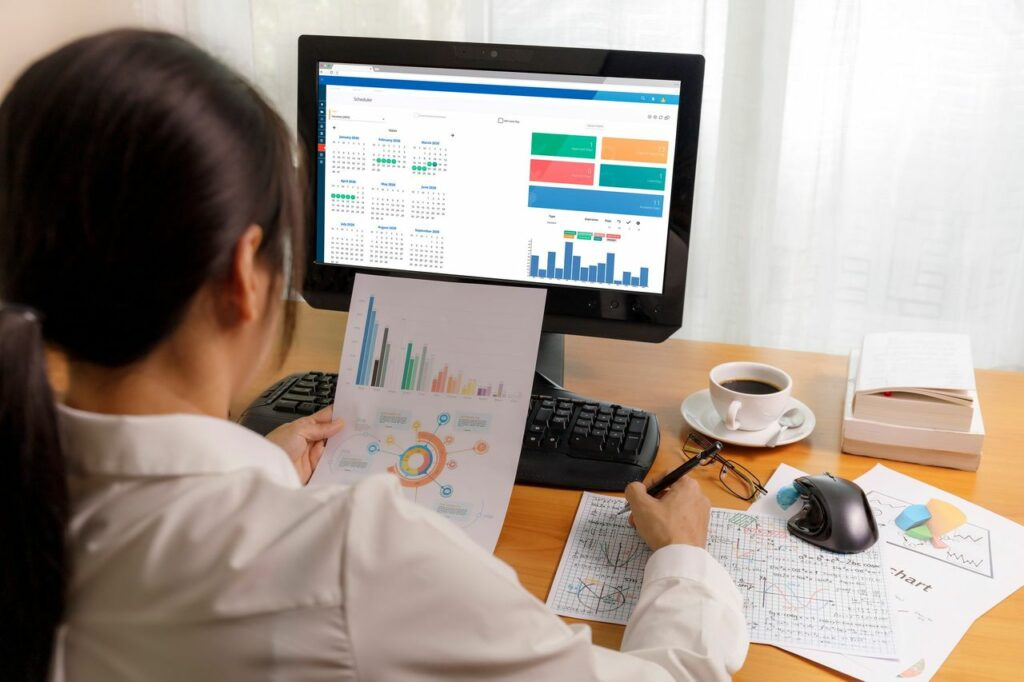 A healthcare professional checking financial data for revenue cycle management